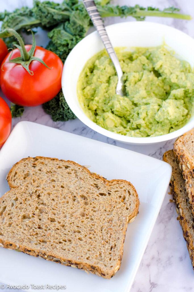 Wheat bread on a plate with pesto avocado