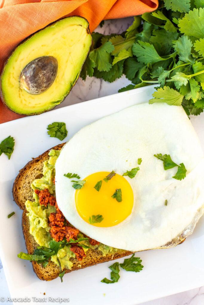 avocado toast with egg and chorizo sausage